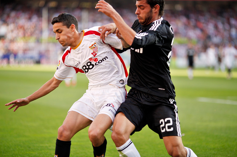 Jesus Navas (Sevilla, left) and Miguel Torres (R. Madrid, right). Spanish Liga football game between Sevilla FC and Real Madrid CF that took place at Sanchez Pizjuan stadium, Seville, Spain, on 26 April 2009