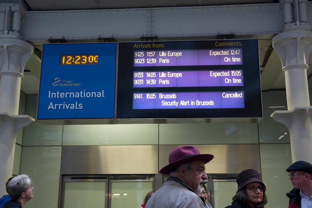 """. A Eurostar train arrivals board shows the Brussels route is cancelled due to \""""Security Alert in Brussels\"""", at St Pancras international railway station in London, Tuesday, March 22, 2016. Authorities in Europe and beyond have tightened security at airports, on subways, at the borders and on city streets after deadly attacks Tuesday on the Brussels airport and its subway system. (AP Photo/Matt Dunham)"""