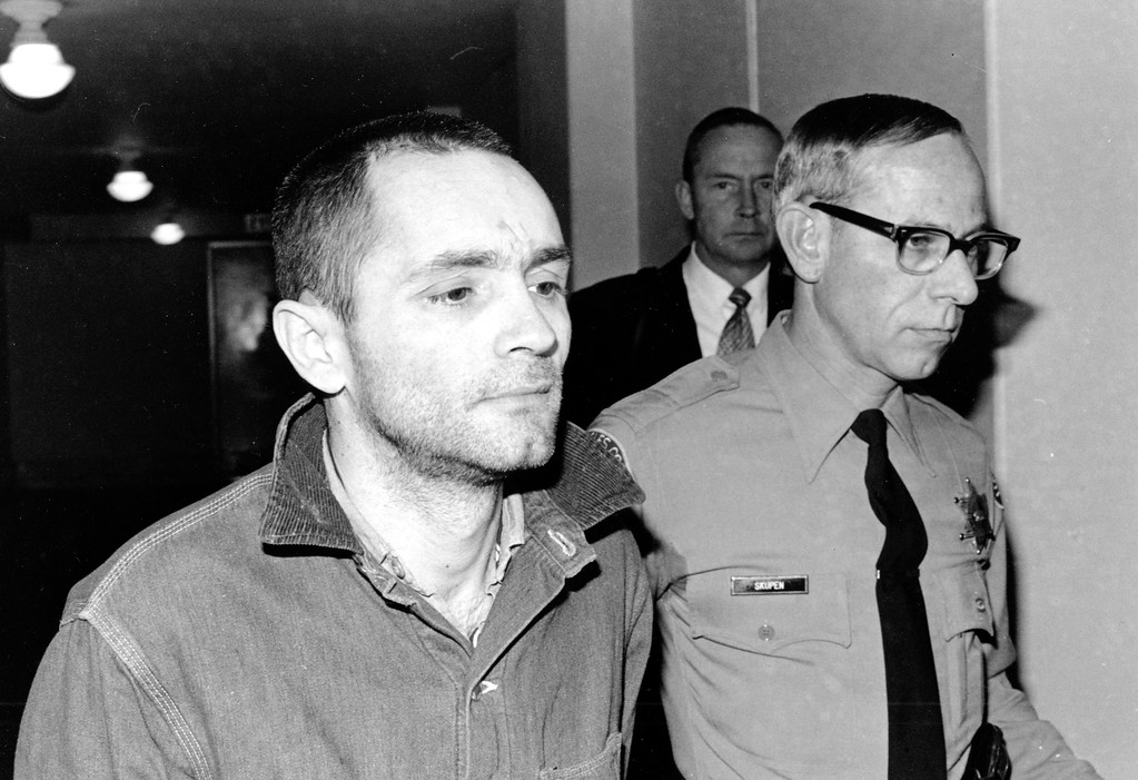 . Charles Manson is escorted to court for formal sentencing in Los Angeles, Ca., on April 19, 1971.  He is convicted with three women followers of murder-conspiracy in the slayings of actress Sharon Tate and six others.  (AP Photo)