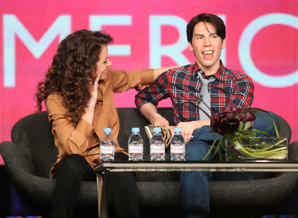 "Description of . Actors Tatiana Maslany (L) and Jordan Gavaris speak onstage at the ""Orphan Black\"" panel discussion during the BBC America portion of the 2013 Winter TCA Tour- Day 2 at Langham Hotel on January 5, 2013 in Pasadena, California.  (Photo by Frederick M. Brown/Getty Images)"