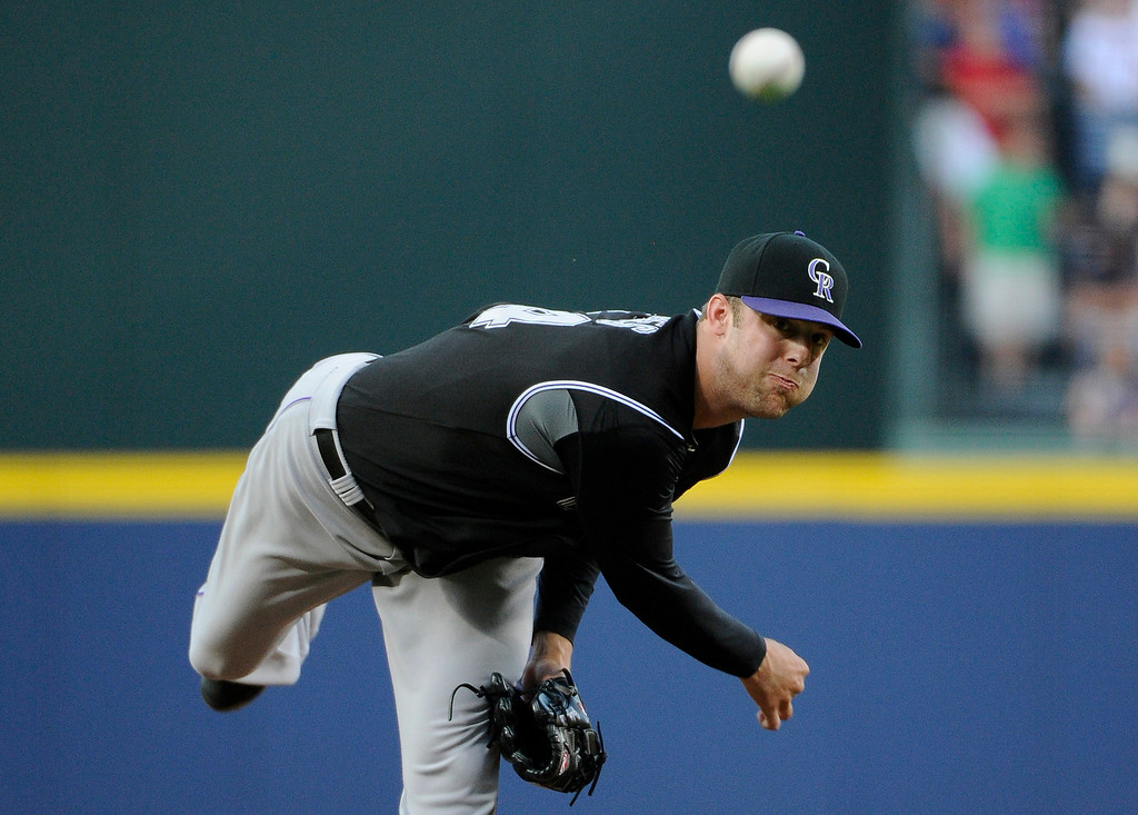 . Colorado Rockies starting pitcher Jordan Lyles delivers to the Atlanta Braves during the first inning of a baseball game Friday, May 23, 2014, in Atlanta. (AP Photo/David Tulis)