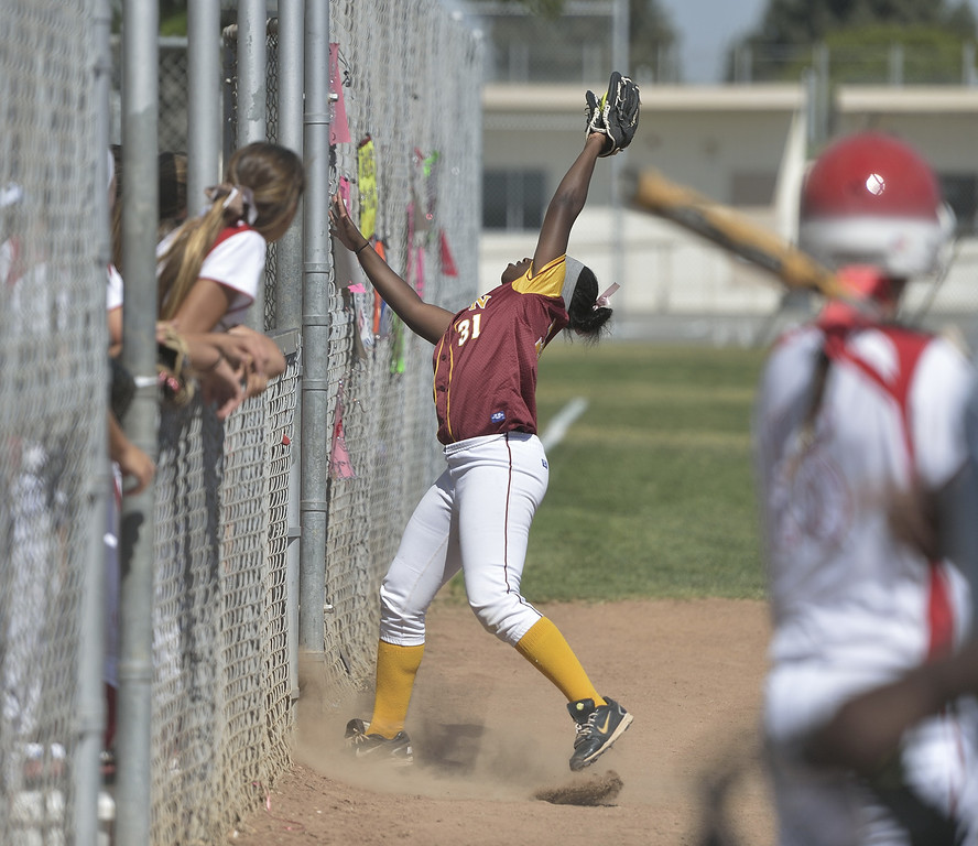 . LONG BEACH, CALIF. USA -- Wilson\'s Kori Cochran (11) goes after a foul ball Lakewood during their Moore League game in Lakewood, Calif., on May 2, 2013. Lakewood defeated Wilson 11-1 in five innings.  Photo by Jeff Gritchen / Los Angeles Newspaper Group