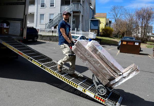 4/2/2020 Mike Orazzi | Staff Napoli Foods' Jacob Dube delivers food to West End Pizza in Bristol on Thursday.