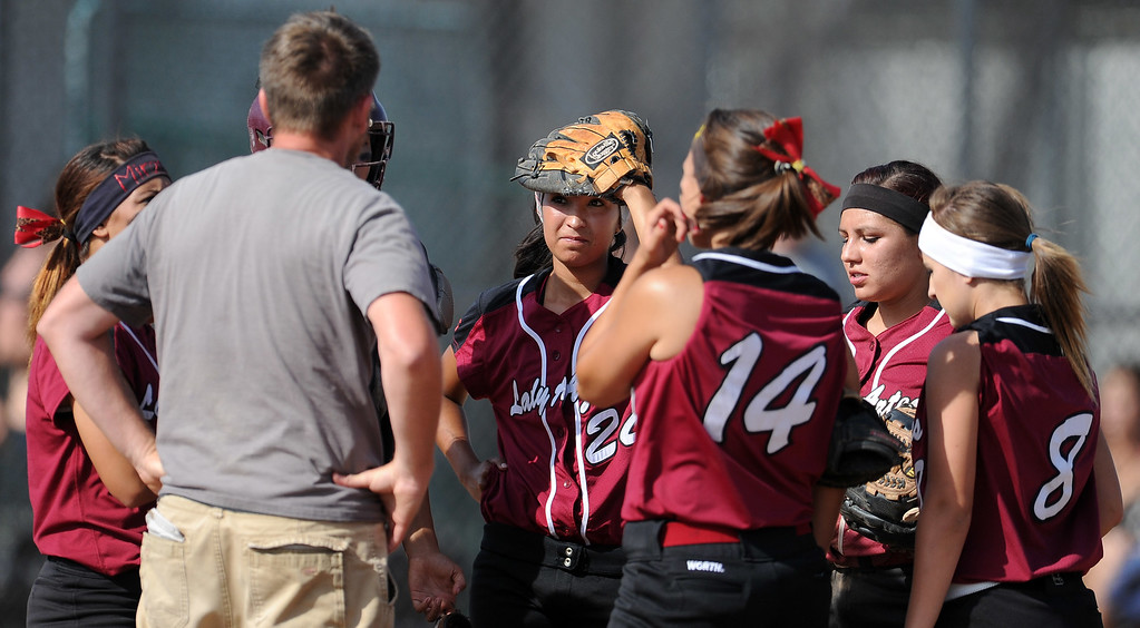 . Barstow head coach Richard Johannsen talks to his team after giving-up the go ahead run in the sixth inning of a CIF-SS quarterfinal playoff softball game against Northview at Northview High School on Thursday, May 23, 2013 in Covina, Calif. Northview won 5-4.  (Keith Birmingham Pasadena Star-News)