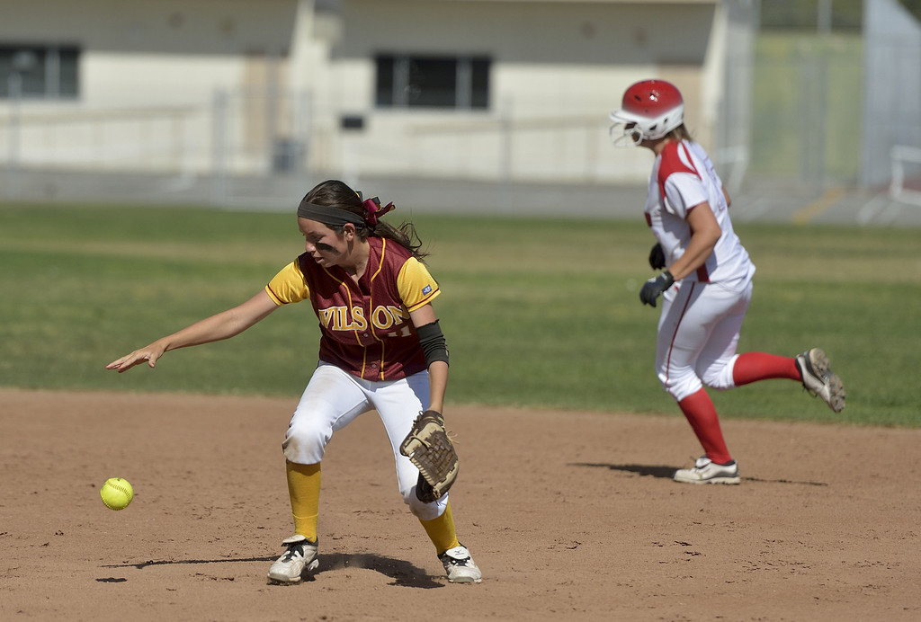 . LONG BEACH, CALIF. USA -- Wilson\'s Kori Cochran (11) drops the fly ball against Lakewood in Lakewood, Calif., on May 2, 2013. If Cochran had held on to the ball the inning would have been over, instead Lakewood went on to score more runs. Lakewood defeated Wilson 11-1 in five innings. Photo by Jeff Gritchen / Los Angeles Newspaper Group