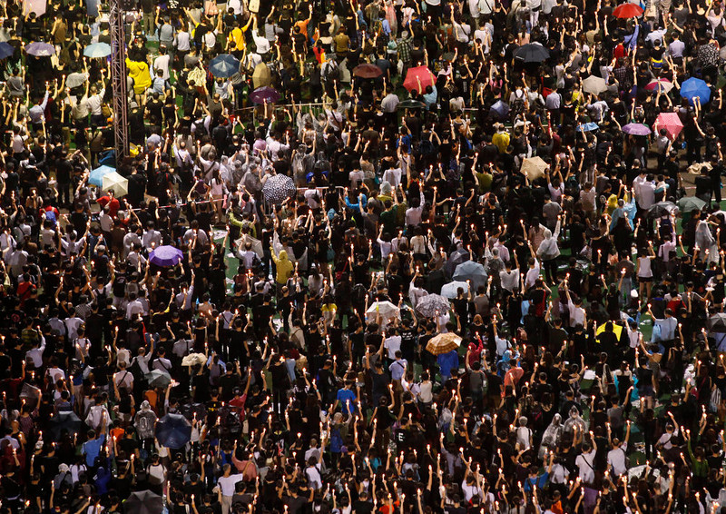 . Tens of thousands of people attend a candlelight vigil at Victoria Park in Hong Kong Tuesday June 4, 2013 to mark the 24th anniversary of the June 4th Chinese military crackdown on the pro-democracy movement in Beijing. (AP Photo/Kin Cheung)
