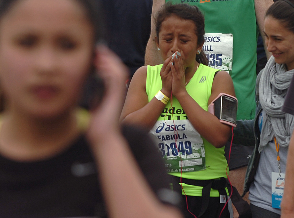 . Fabiola Aquino, 14 of Los Angeles, is overwhelmed after completion of the L.A. Marathon in Santa Monica March 17, 2013. (Thomas R. Cordova/Staff Photographer)