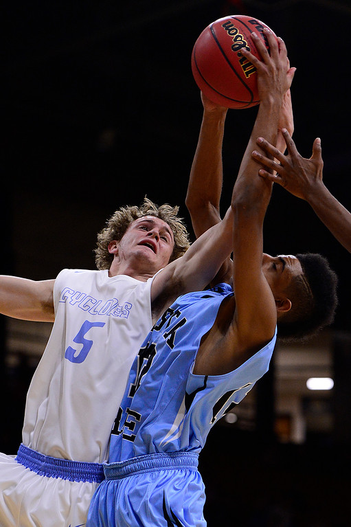 . Kenneth Tack (5) of Pueblo West battles with Raymon Harper (12) of Vista Ridge over a rebound during the second quarter at the Coors Events Center on March 11, 2016 in Boulder, Colorado. (Photo by Brent Lewis/The Denver Post)