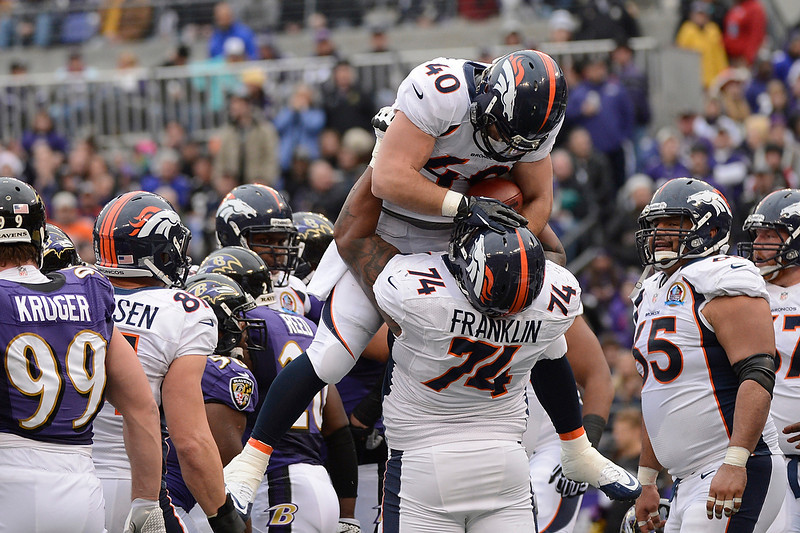 . Denver Broncos running back Jacob Hester #40 is lifted by Denver Broncos tackle Orlando Franklin #74 after he scored the first touchdown of the game at the M&T Bank Stadium, in Baltimore, MD Sunday December 16, 2012.      Joe Amon, The Denver Post