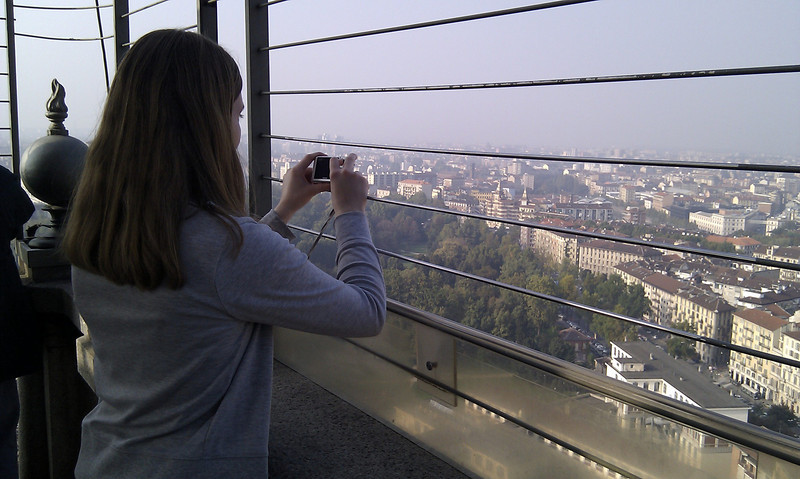 Becky taking a photo of the sky line of Turin