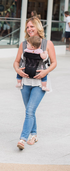 Izmi_Baby_Carrier_Breeze_Mid_Grey_Lifestyle_Front_Carry_Mum_Shopping_Portrait.jpg