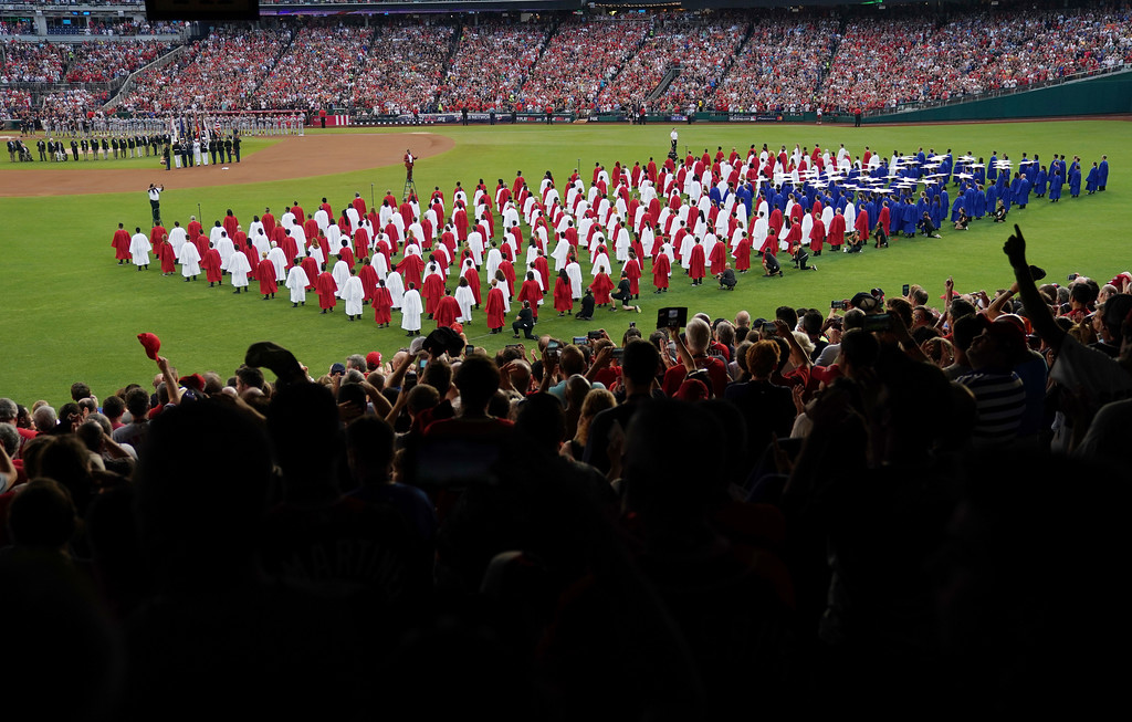 . A choir moves on the field before the 89th MLB baseball All-Star Game, Tuesday, July 17, 2018, at Nationals Park, in Washington. (AP Photo/Carolyn Kaster)