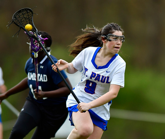 5/2/2019 Mike Orazzi | Staff St. Paul's Madeline Fisher (9) during Thursday's girls lacrosse with Amistad in Bristol.