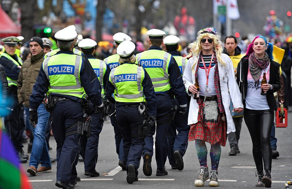 . Police secures the traditional carnival parade in Duesseldorf, Germany, Monday, Feb. 26, 2017. The foolish street spectacles in the carnival centers of Duesseldorf, Mainz and Cologne, watched by hundreds of thousands of people, are the highlights in Germany\'s carnival season on Shrove Monday. (AP Photo/Martin Meissner)