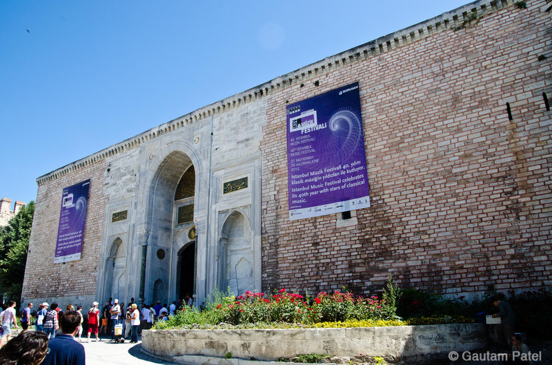 Topkapi Palace, Istanbul outer wall with banner of schedule for live classical music concerts : Turkey June 2012