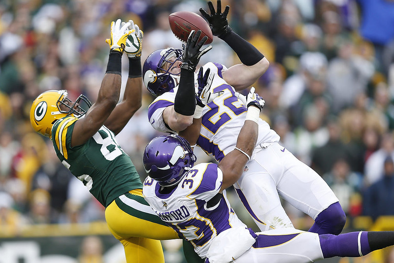 . Harrison Smith #22 of the Minnesota Vikings intercepts a pass intended for Greg Jennings #85 of the Green Bay Packers during the game at Lambeau Field on December 2, 2012 in Green Bay, Wisconsin. The Packers won 23-14. (Photo by Joe Robbins/Getty Images)