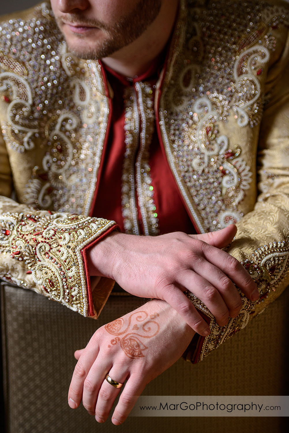 hands of the indian groom at DoubleTree by Hilton Pleasanton at the Club