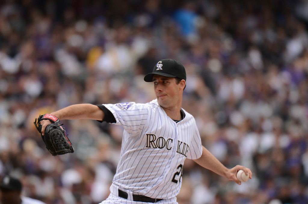 . Jeff Francis (26) of the Colorado Rockies delivers a pitch in the first inning.(Photo by Hyoung Chang/The Denver Post)