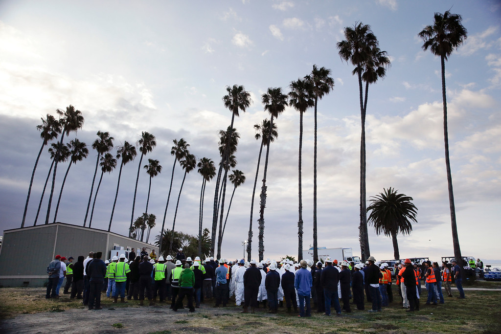 . Oil spill clean-up crew members gather for a morning briefing at Refugio State Beach, north of Goleta, Calif., Thursday, May 21, 2015. More than 6,000 gallons of oil had been raked, skimmed and vacuumed from a spill that stretched across 9 miles of California coast in a cleanup effort that is now going 24 hours a day, officials said, but that\'s just a fraction of the sticky, stinking goo that escaped from a broken pipeline. (AP Photo/Jae C. Hong)