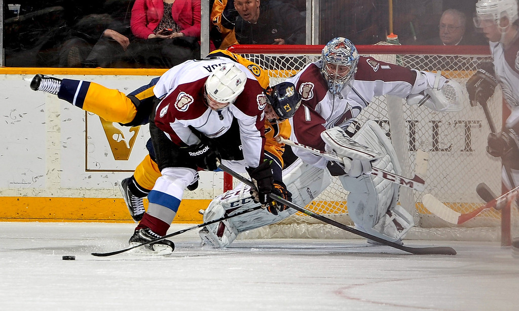 . Jan Hejda #8 of the Colorado Avalanche gets tied up by Patric Hornqvist #27 of the Nashville Predators at Bridgestone Arena on March 25, 2014 in Nashville, Tennessee.  (Photo by Frederick Breedon/Getty Images)