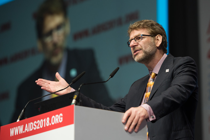 22nd International AIDS Conference (AIDS 2018) Amsterdam, Netherlands   Copyright: Marcus Rose/IAS  Photo shows: Plenary Session. Anton Pozniak and Positive Flame video link.