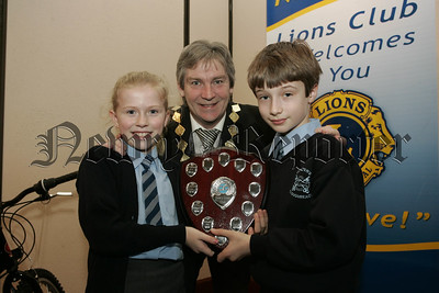 Courtney Magee and Jamie McAteer from St Peter's Cloughreagh recieve the award of best rural school in the Lions Club schools swimming prizegiving from Vice-President Tony Quinn. 07W6N15