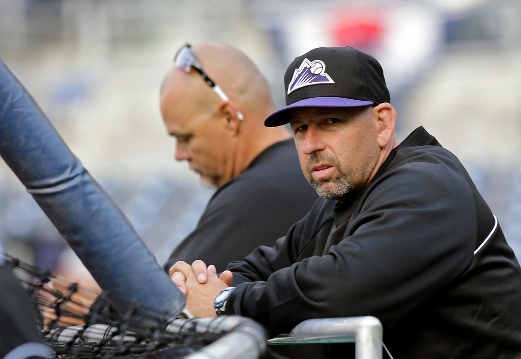 . Colorado Rockies manager Walt Weiss, right, watches batting during pregame warm ups for a baseball game against the San Diego Padres, Friday April 12, 2013, in San Diego. (AP photo/Lenny Ignelzi)
