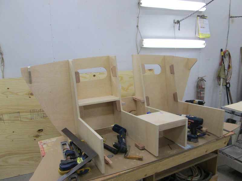 Another view of the front seat frame with storage compartments being built.