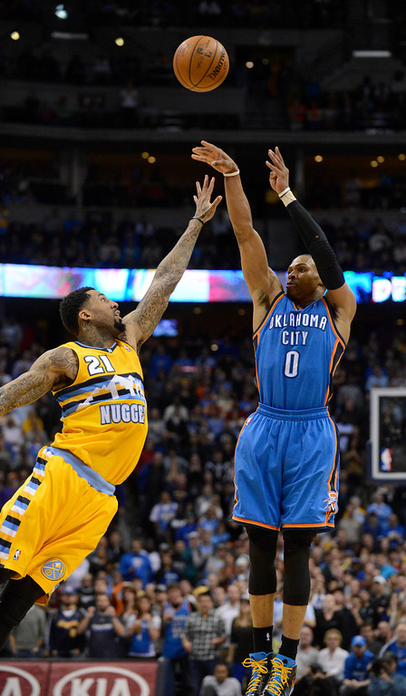 . DENVER, CO. - JANUARY 20: Oklahoma City Thunder point guard Russell Westbrook (0) hits a jump shot over Denver Nuggets shooting guard Wilson Chandler (21) to tie the game and send it to overtime January 20,  2013 at Pepsi Center. The Denver Nuggets defeated the Oklahoma City Thunder 121-118.  (Photo By John Leyba / The Denver Post)