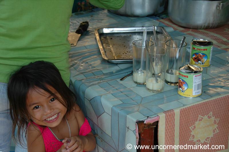 Smiling Kid with Condensed Milk - Phnom Penh, Cambodia