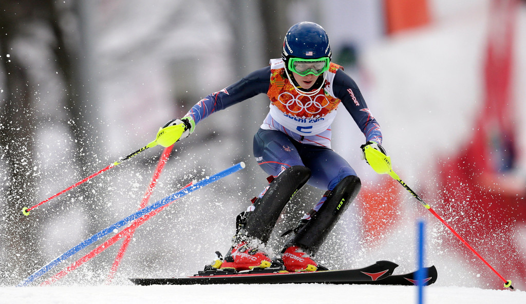 . United States\' Mikaela Shiffrin skis past a gate in the first run of the women\'s slalom at the Sochi 2014 Winter Olympics, Friday, Feb. 21, 2014, in Krasnaya Polyana, Russia. (AP Photo/Charles Krupa)