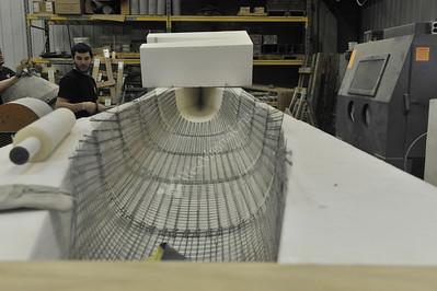 27468 Students making concret canoe