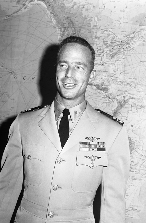 . Astronaut Scott Carpenter, Navy Lieutenant Commander, poses with the Navy?s astronaut wings below his regular Navy flight wings, June 25, 1962 in Washington after they were presented to him at a Pentagon ceremony. Carpenter orbited the earth three times duplicating the feat of John Glenn in a flight from Cape Canaveral, Florida. (AP Photo)