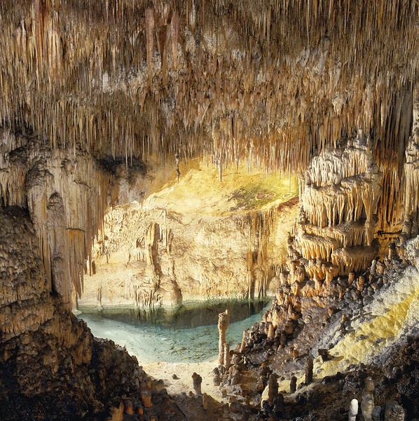 interior of cave with spiky stalactites