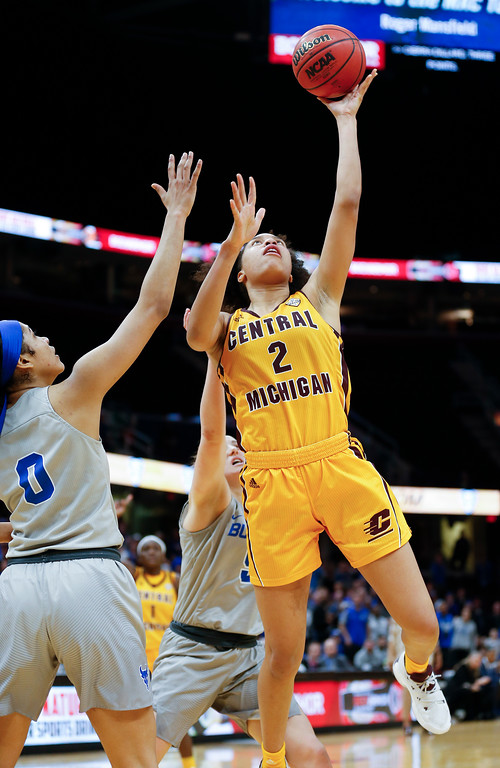. Central Michigan forward Tinara Moore shoots over Buffalo forward Summer Hemphill during the second half of an NCAA college basketball game in the championship of the Mid-American Conference tournament Saturday, March 10, 2018, in Cleveland. Central Michigan won 96-91. (AP Photo/Ron Schwane)