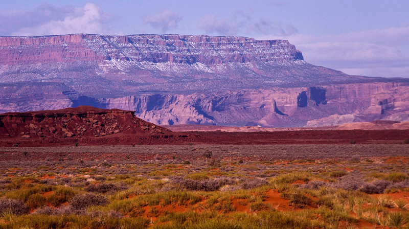 From the road - between Mexican Hat, UT and Monument Valley, AZ.  Colors were truly amazing - the desert soils were wet and the sky was filled with pink sand.