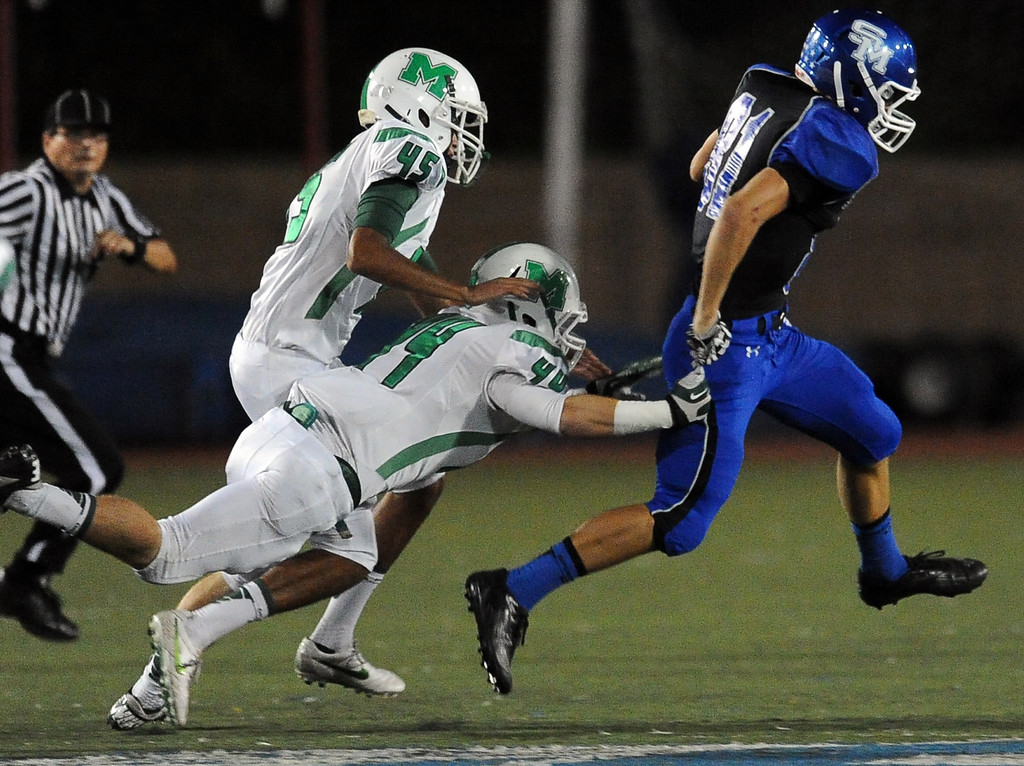 . San Marino\'s Aiden Santino (18) is chased by Monrovia\'s Blake Cusick (45) and Zach Zapeda (44) in the first half of a prep football game at Monrovia High School in Monrovia, Calif., on Friday, Nov. 8, 2013. Santino would fumble on the play and Monrovia would recover the ball.    (Keith Birmingham Pasadena Star-News)