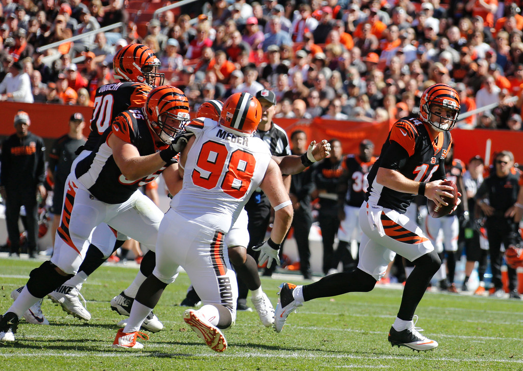 . Cincinnati Bengals quarterback Andy Dalton (14) scrabbles in the first half of an NFL football game against the Cleveland Browns, Sunday, Oct. 1, 2017, in Cleveland. (AP Photo/Ron Schwane)