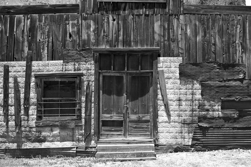 """General Store no more.  Mogollon, New Mexico is a fascinating little town at the end of a road to, well, Mogollon, and nowhere else.  That means it's not like other places because nobody goes there who doesn't live there, except guys like me who see little used roads and think, """"Hmm, I wonder where that goes?""""  Sometimes, my camera and I are rewarded for finding out where the road goes.  You may also have noticed that to me the world is a vivid place.  I don't do a lot of b&w work, but sometimes a subject just begs for it.  I try to be accommodating."""