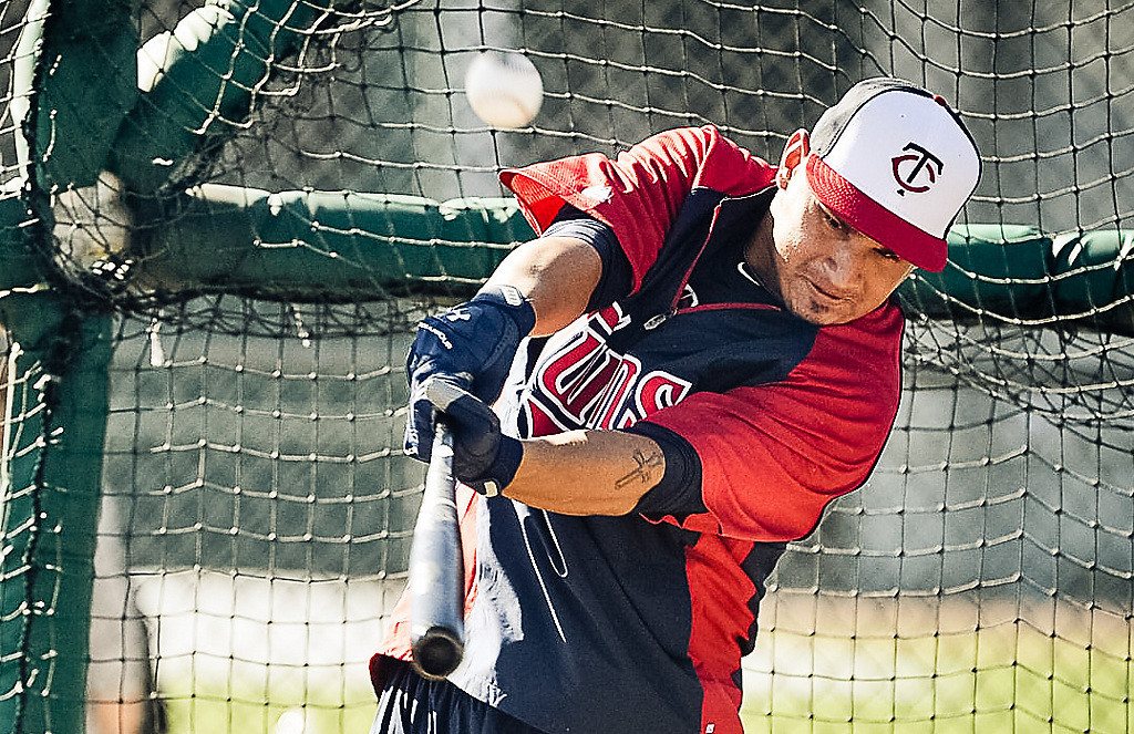 . Twins outfielder Oswaldo Arcia pops one up during batting practice. (Pioneer Press: Ben Garvin)