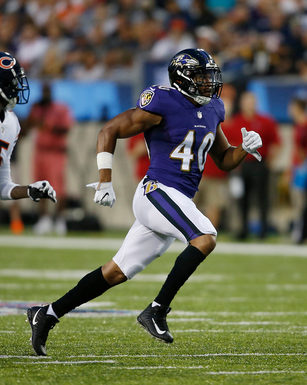 . Baltimore Ravens linebacker Kenny Young runs a route against the Chicago Bears in the first half at the Pro Football Hall of Fame NFL preseason game, Thursday, Aug. 2, 2018, in Canton, Ohio. (AP Photo/Ron Schwane)