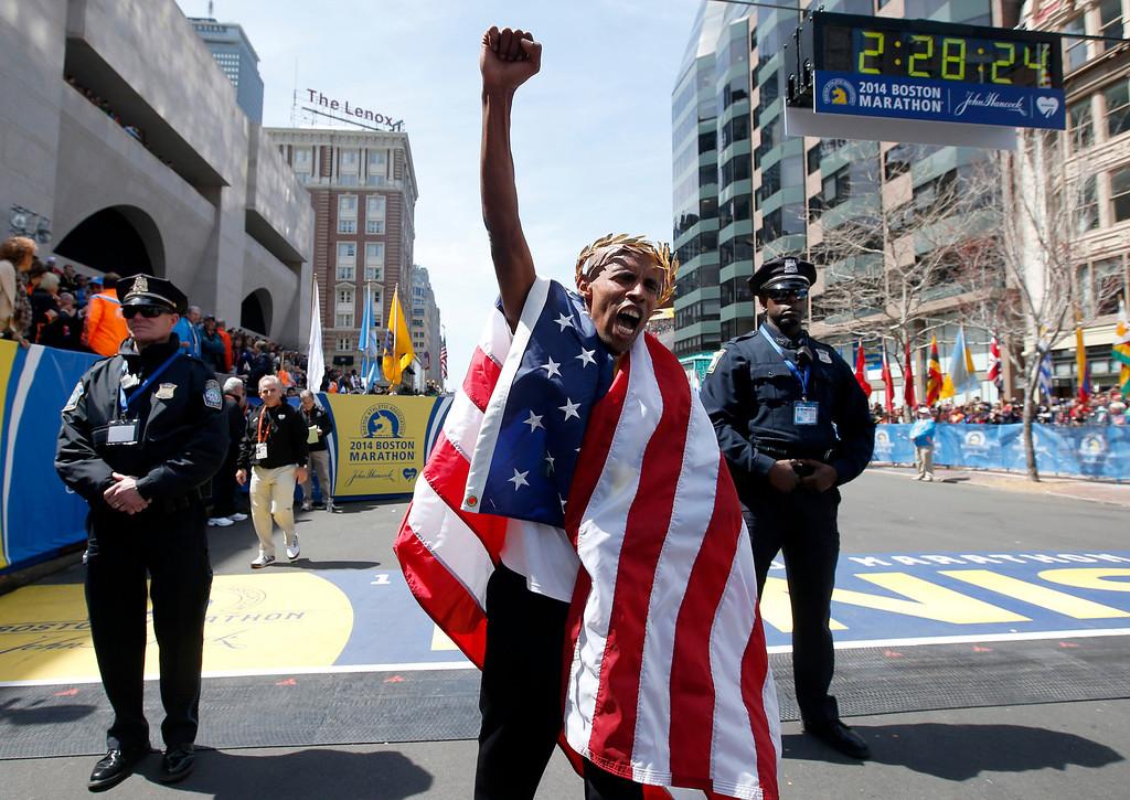 . Meb Keflezighi, of San Diego, Calif., celebrates his victory in the 118th Boston Marathon, Monday, April 21, 2014, in Boston.(AP Photo/Elise Amendola)