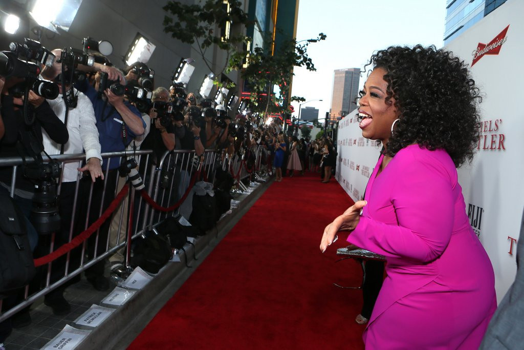 """. <p><b> Oprah Winfrey says she came face-to-face with racism when a store clerk made an assumption that she did not have enough money to buy � </b> <p> A. An expensive handbag  <p> B. A diamond necklace  <p> C. Every newspaper in America  <p>   (Alexandra Wyman/Invision/AP Images) <p><b><a href=\'http://www.twincities.com/national/ci_23828164/oprah-gets-swiss-apology-racist-encounter?source=hottopics\' target=\""""_blank\""""> HUH?</a></b>"""