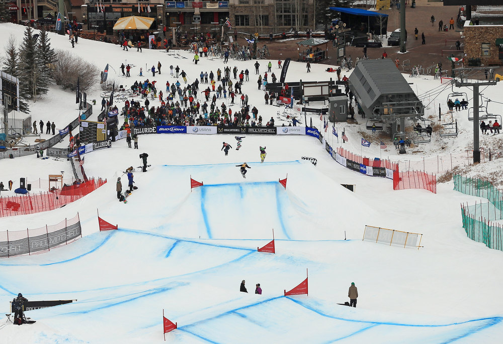 . Competitors descend the course to the finish line during the the USANA Snowboardcross World Cup Team Event on December 15, 2012 in Telluride, Colorado.  (Photo by Doug Pensinger/Getty Images)