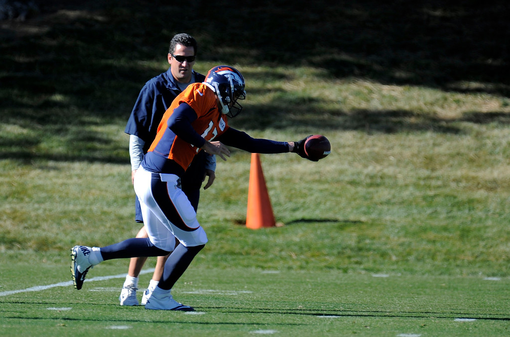 . Denver Broncos quarterback Brock Osweiler (17) takes the snap during practice November 13, 2013 at Dove Valley. Brock took the snaps on the day as Peyton Manning was held out of practice. (Photo by John Leyba/The Denver Post)
