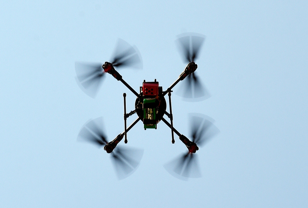 . LONGMONT, CO - AUGUST 9: The drone prepares to land. Arbor Drone LLC and Spectrabotics LLC,  collected data using drone flights over northwest Longmont on August 9, 2018, to study and monitor trees affected by Emerald Ash Borer (EAB).  Longmont will be one of the last EAB detection flights for 2018 for the team. Drone flights in urban areas to study tree pests have never been conducted at this scale. (Photo by Cliff Grassmick/Staff Photographer)