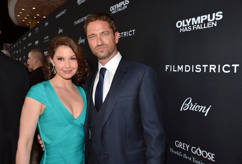 """. Actors Ashley Judd (L) and Gerard Butler arrive at the premiere of FilmDistrict\'s \""""Olympus Has Fallen\"""" at ArcLight Cinemas Cinerama Dome on March 18, 2013 in Hollywood, California.  (Photo by Alberto E. Rodriguez/Getty Images)"""