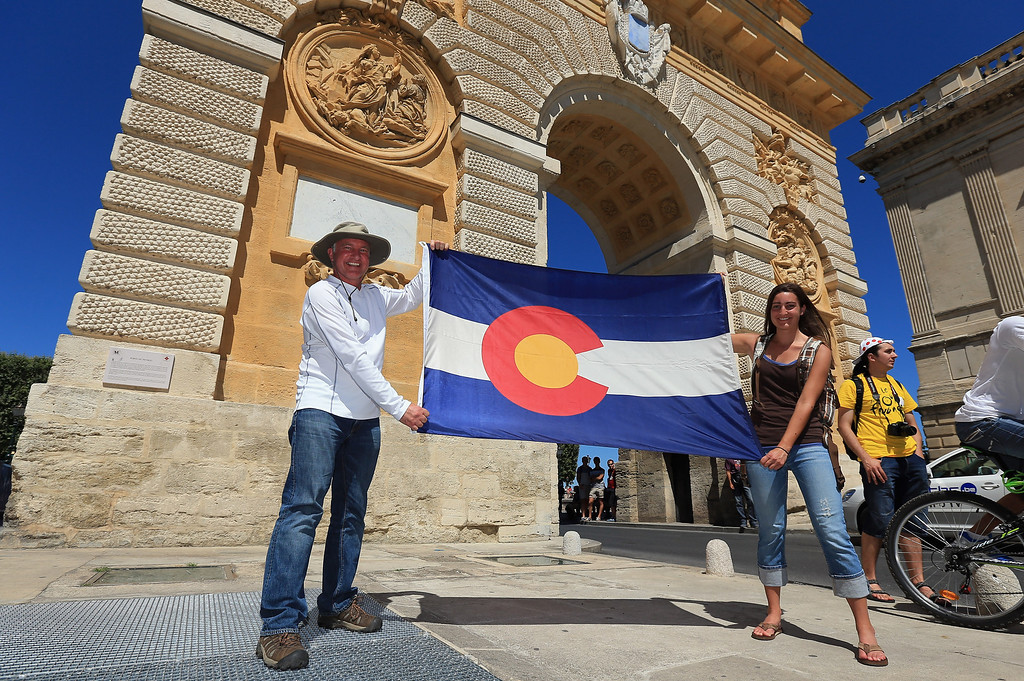 . ALBI, FRANCE - JULY 05:  Joe and Julie Price of Colorado Springs display a Colorado flag near the start of stage seven of the 2013 Tour de France, a 205.5KM road stage from Montpellier to Albi, on July 5, 2013 in Albi, France.  (Photo by Doug Pensinger/Getty Images)