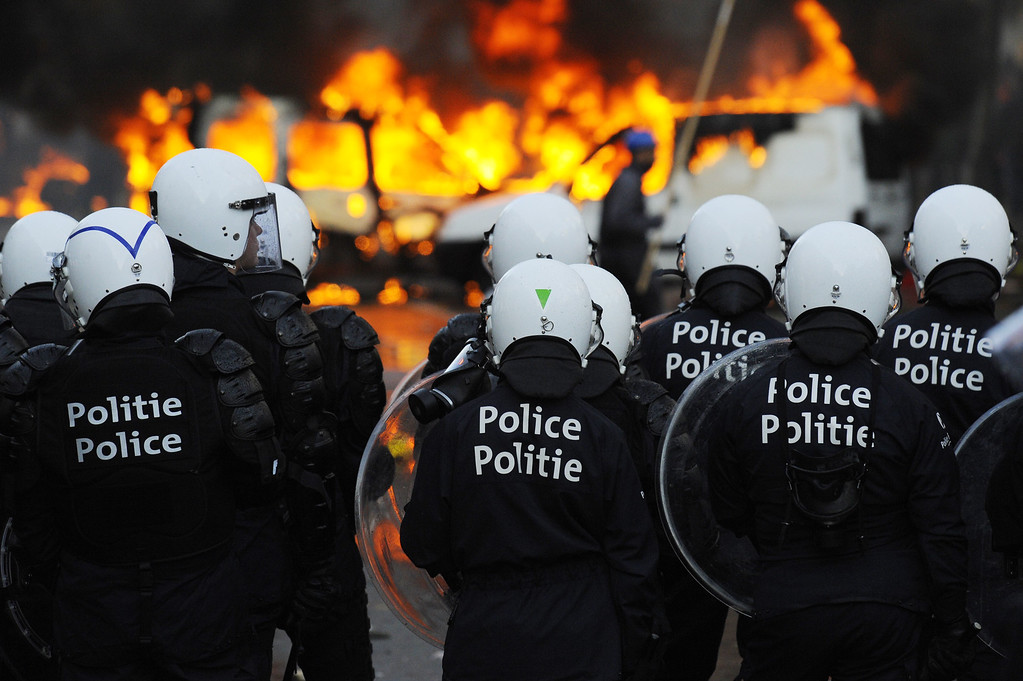 . Riot police officers face demonstrators on November 6, 2014 in Brussels in the first mass protest against the new centre-right government\'s austerity policies.  AFP PHOTO / JOHN THYS/AFP/Getty Images