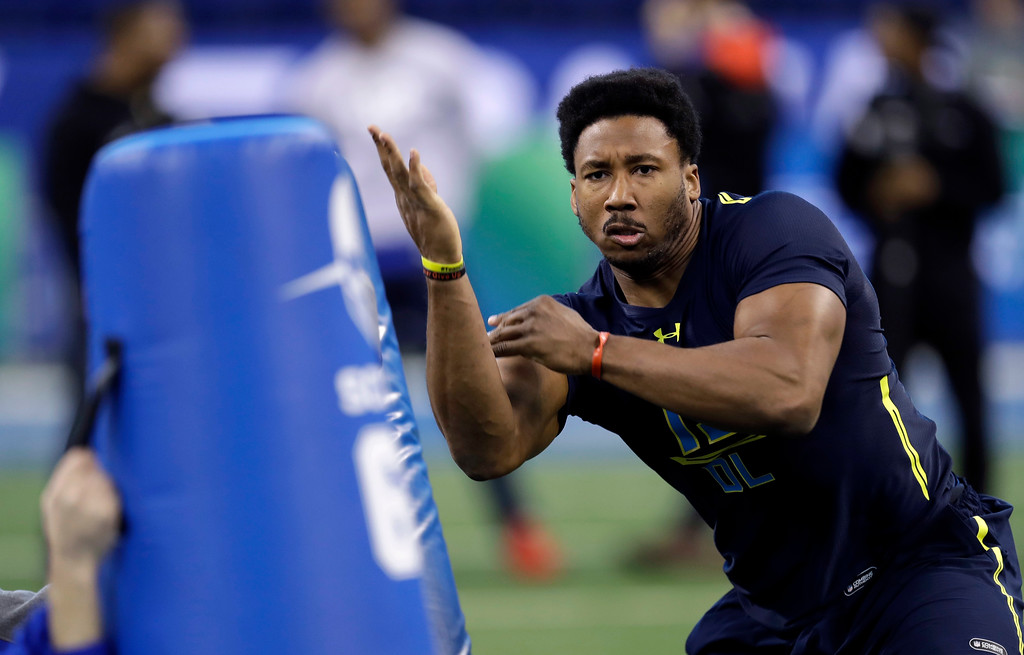 . Texas A&M defensive end Myles Garrett hits a blocking dummy during a drill at the NFL football scouting combine Sunday, March 5, 2017, in Indianapolis. (AP Photo/David J. Phillip)